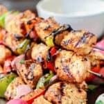 Mediterranean Grilled Chicken Kabobs Recipe + Cayenne Tahini Sauce! Make chicken kabobs like a Mediterranean pro! Marinated in Mediterranean spices with fresh garlic and lime juice, these kabobs are simply succulent! Try them for your next party with an easy tahini sauce!