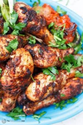 Grilled Chicken Drumsticks with Spicy Garlic Harissa Marinade