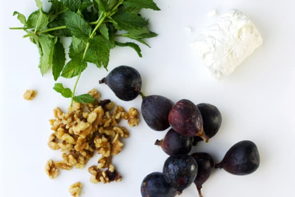 Figs, mint, goat cheese and walnuts on the table