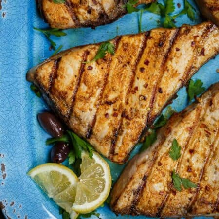 grilled sword fish with a side of limes