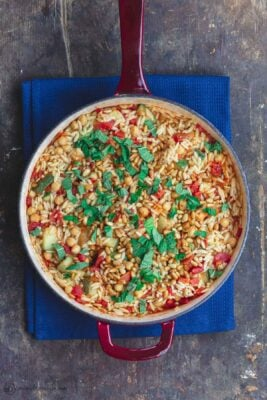 Orzo with zucchini, Chickpeas and Tomatoes. Garnished with mint and pine nuts