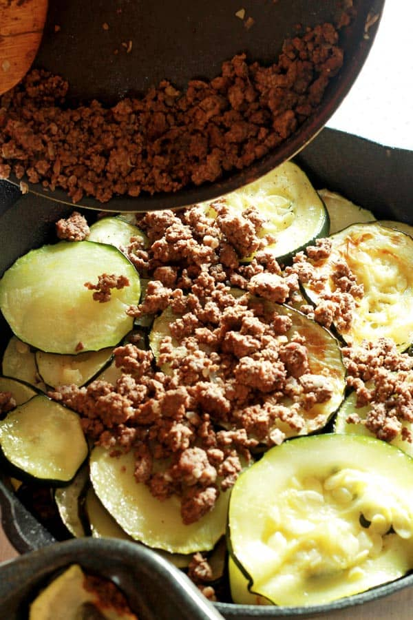 Additional ground beef added to top of zucchini layer