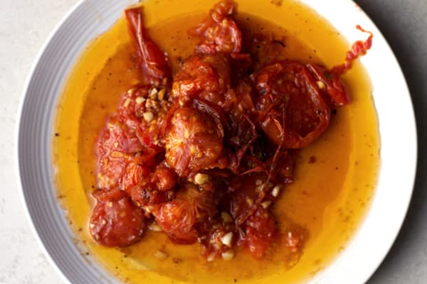 Bowl of fried tomatoes, oil and spices