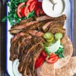 Grilled Beef Shawarma Recipe | The Mediterranean Dish. Learn how to make homemade beef shawarma and mix your own shawarma spices. This easy shawarma recipe from themediterraneandish.com will become a regular! And we show you what to serve along! #shawarma #beefshawarma #mediterraneanrecipes #mediterraneandiet #middleeasternfood