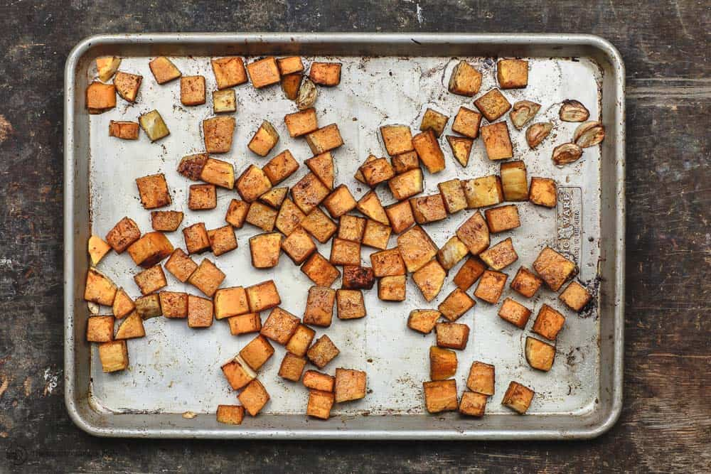 Butternut squash cubes, seasoned and roasted with olive oil and garlic cloves