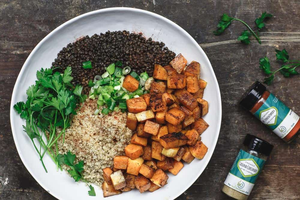 To assemble this easy roasted butternut squash recipe, combine butternut squash with lentils, quinoa, fresh parsley, green onions and spices