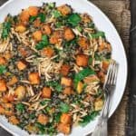 Easy Roasted Butternut Squash Recipe with Lentils and Quinoa. Seasoned with Mediterranean spices. Topped with toasted almond