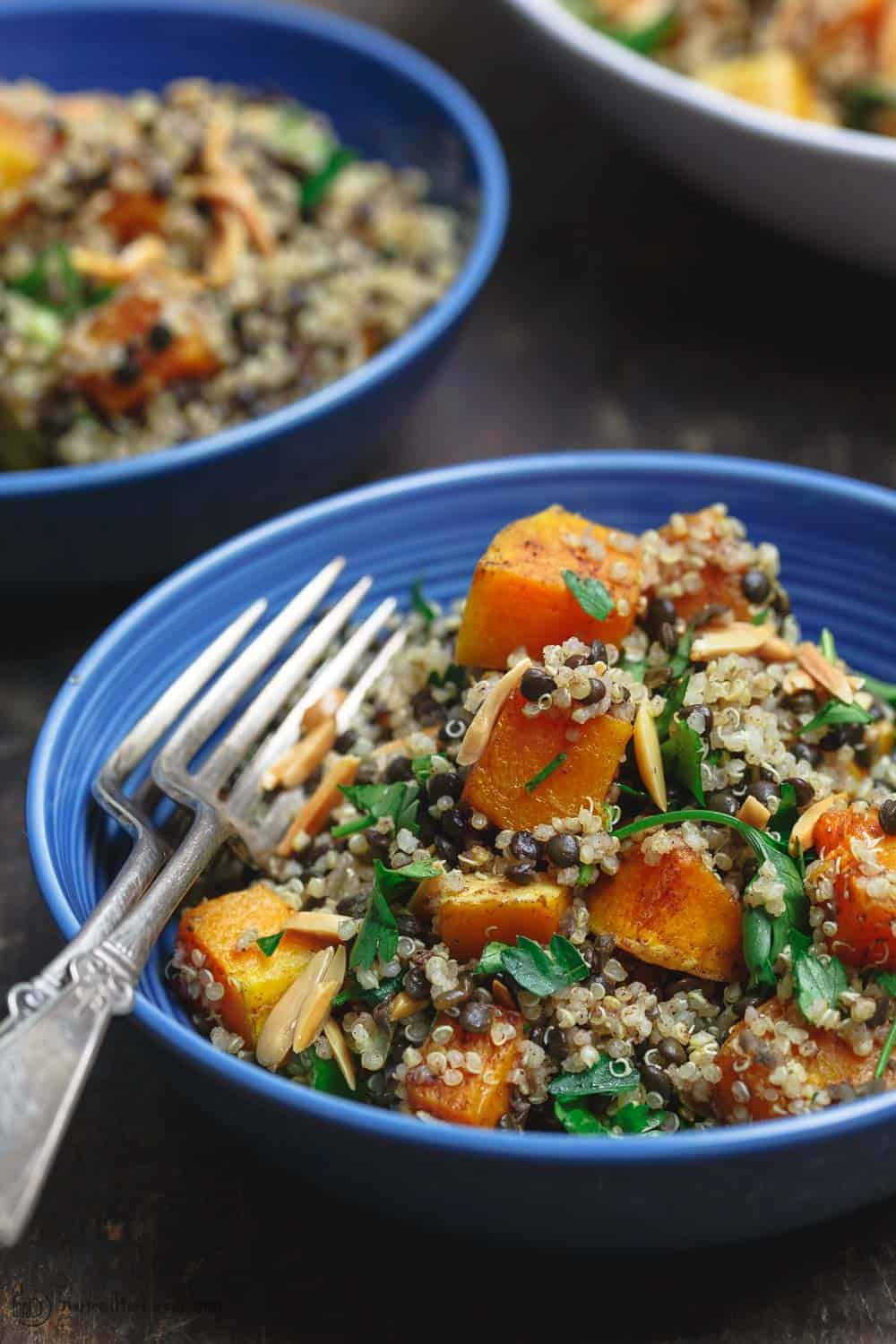 Close up side shot of Easy Roasted Butternut Squash with Lentils and Quinoa. Seasoned with Mediterranean spices and topped with toasted almonds