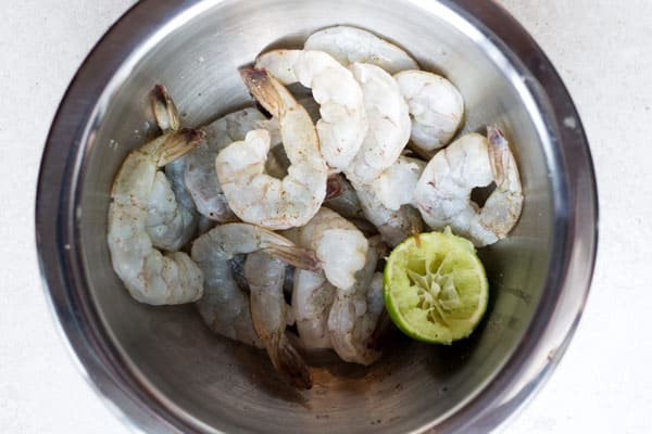 Raw shrimp in a bowl with lime juice