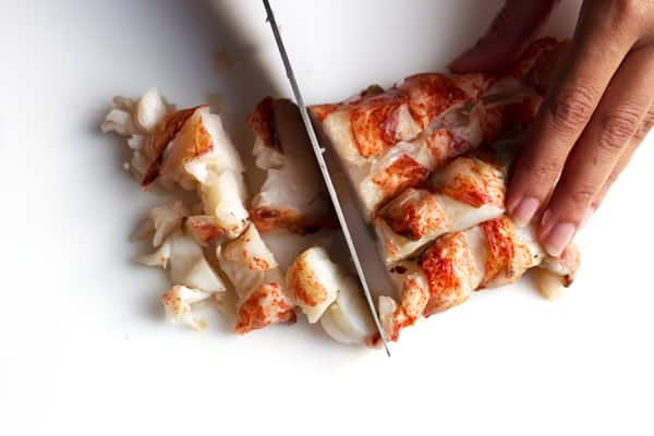 Cutting the lobster meat into pieces