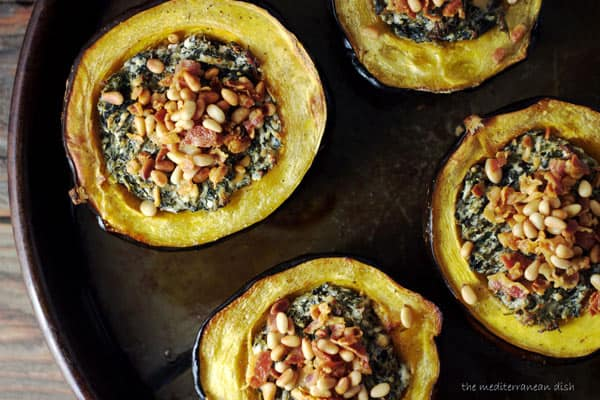 Acorn Squash stuffed with cheese, spinach and topped with pancetta and pine nuts