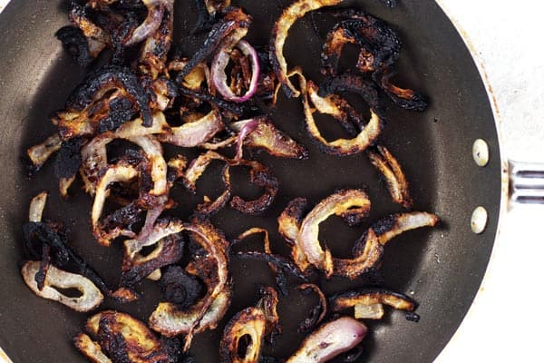 Onions being fried in pan