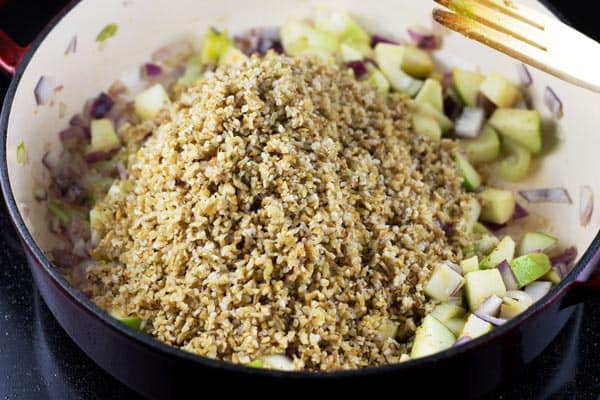 Add freekeh and spices to the cooking skillet