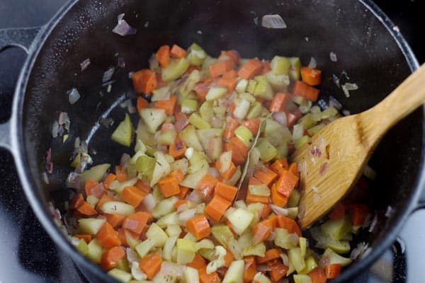 Vegetables added to a pot to be cooked