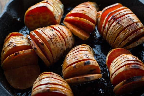 Mediterranean Style Thanksgiving Recipes | The Mediterranean Dish. These hasselback sweet potatoes with pecans and orange glaze along with other recipes from The Mediterranean Dish, David Lebovitz, Yotam Ottolenghi and more!