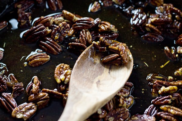 Spoon of caramelized pecans