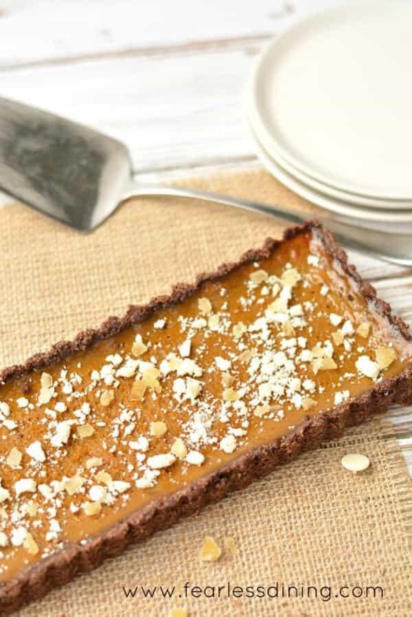 Thanksgiving Recipe for gluten free pumpkin tart with dark rum from Fearless Dining