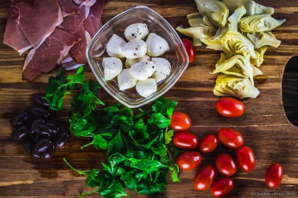 Antipasto skewers with prosciutto, mozzarella, artichokes