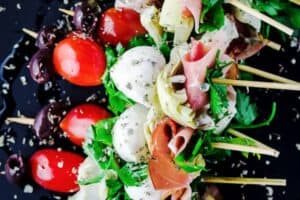 Antipasto skewers with prosciutto, mozzarella, artichokes   The Mediterranean Dish. An easy and impressive party appetizer that comes together in minutes!