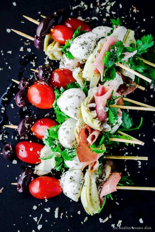 Antipasto skewers with prosciutto, mozzarella, artichokes. Part of 21 Mediterranean Christmas Brunch Recipes | The Mediterranean Dish #christmasbrunch #mediterraneanrecipes #brunchrecipes