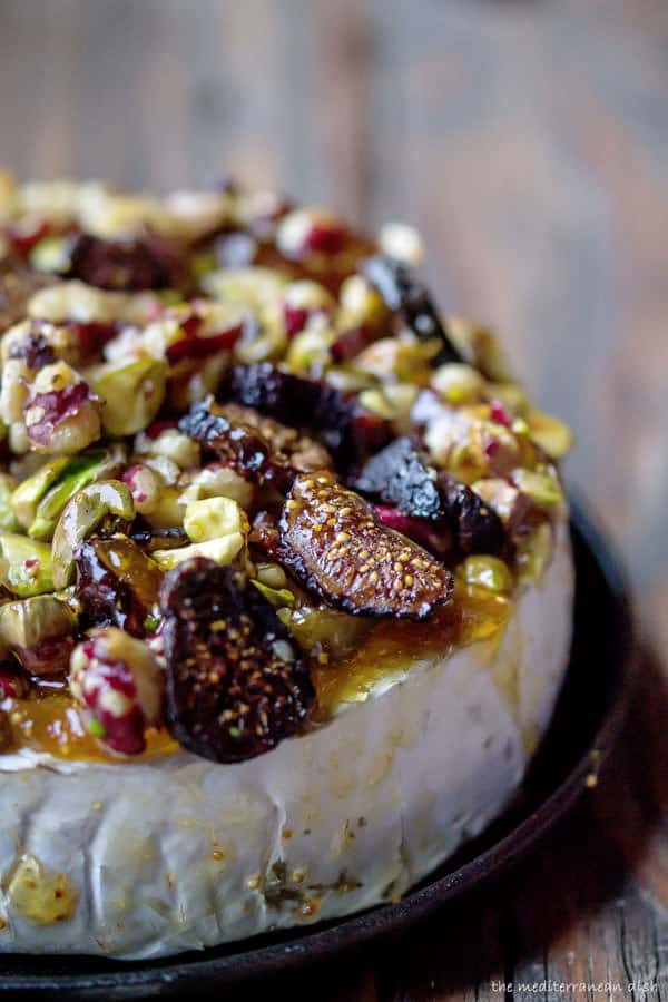 Brie, Topped with Jam and Nuts in a Cast Iron Skillet Before Baking