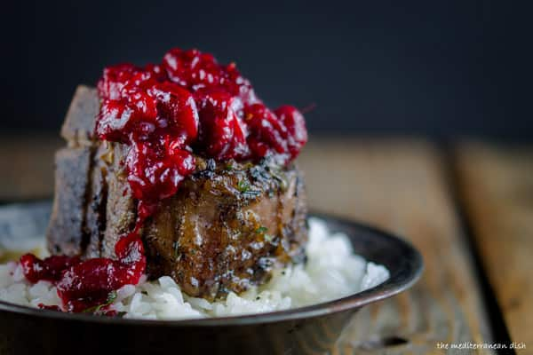Cranberry-Harissa Chutney added to top of Lamb Chop