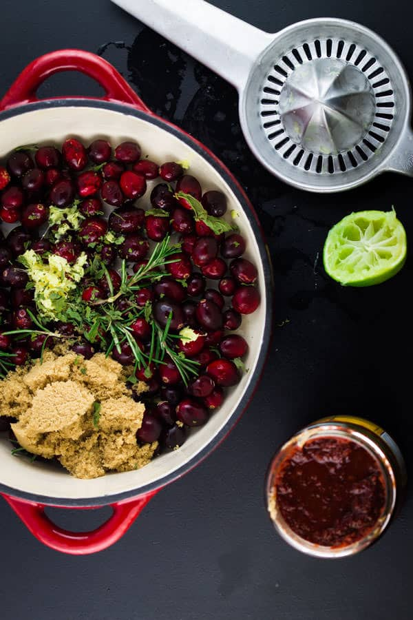 Cranberries, lime juice and brown sugar added to a bowl
