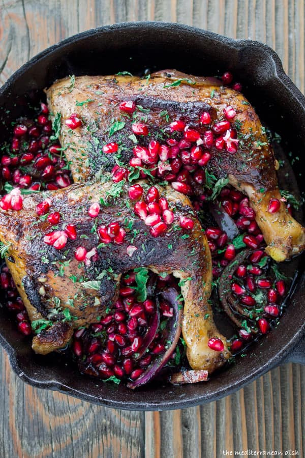 Mediterranean chicken thighs served with extra pomegranate seeds