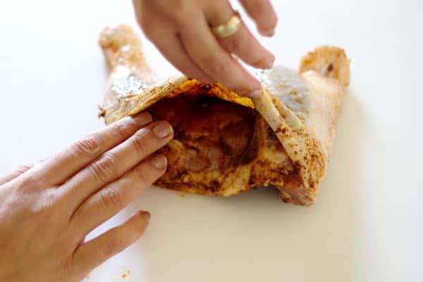 rubbing spice in chicken thighs