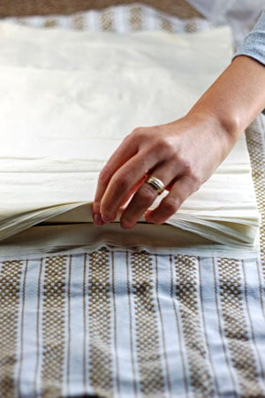 Phyllo sheets placed between two clean and damp cloths.