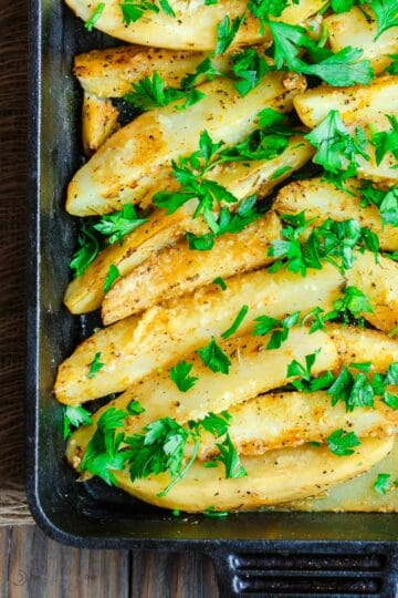 Lemon Roasted Potatoes Greek Style | The Mediterranean Dish. Greek roasted potatoes with lemon, garlic, and a sprinkle of Parmesan. The best roasted potato recipe from themediterraneandish.com