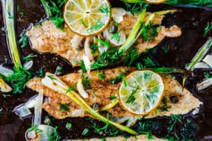 Baked sole fillet prepared Mediterranean style. Get this baked sole fillet with green onion and capers covered in a buttery lime sauce!