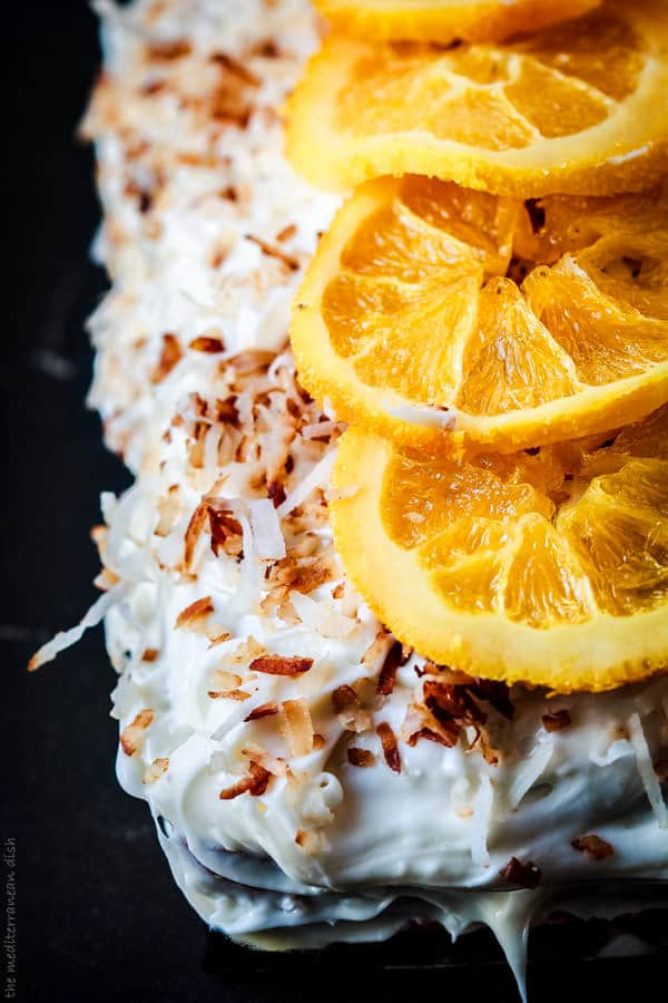 Close-up of Orange Cake with shredded coconut and orange slices