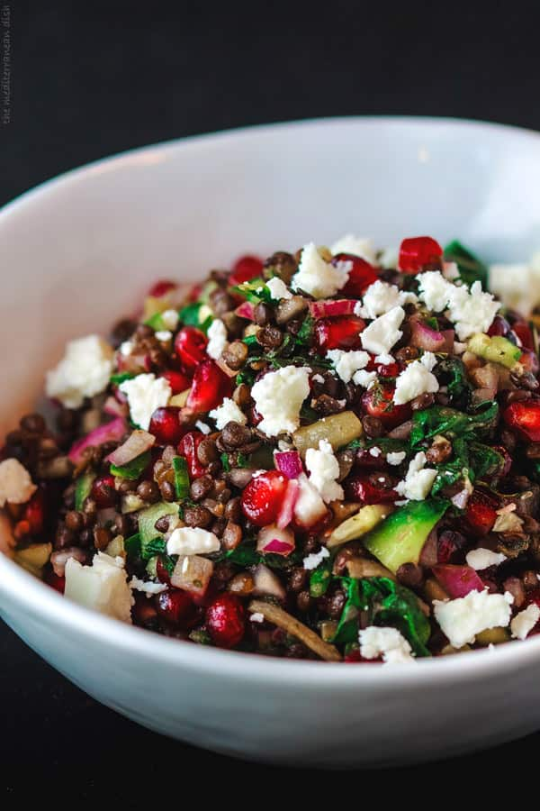 Brown lentil salad garnished with feta cheese