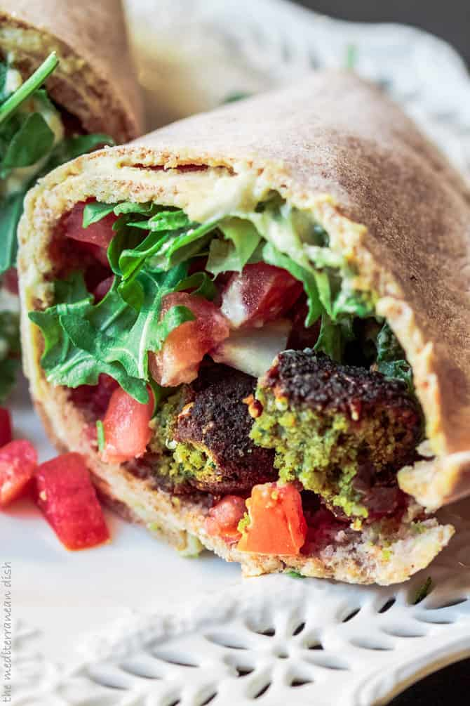 Falafel wraps with fresh vegetables and tahini sauce