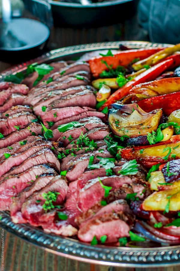 Lamb loin fillets and roasted root vegetables. Easy Mediterranean recipe for grilled lamb loin with a special wine-brandy sauce & roasted root vegetables!