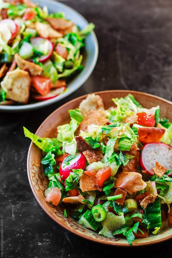 Two servings of Fattoush Salad in bowls