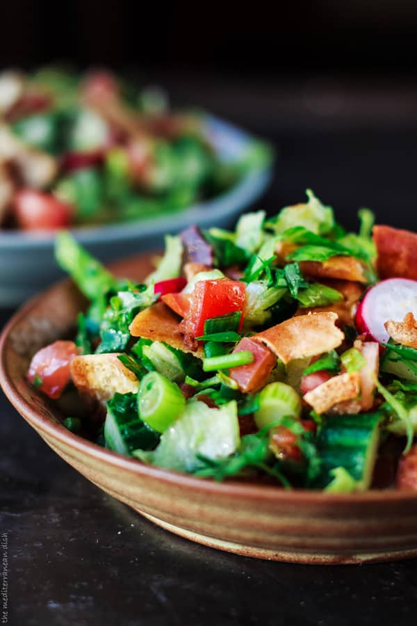 Mediterranean Fattoush Salad topped pita bread
