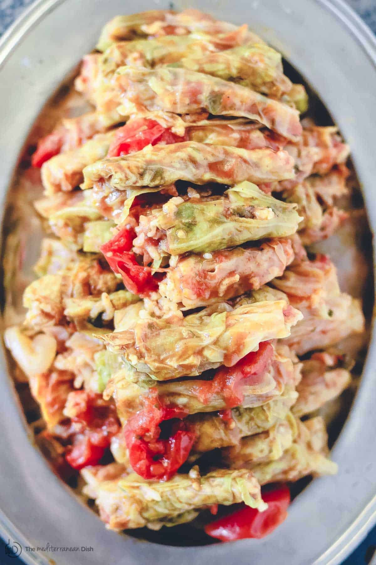 Vegetarian stuffed cabbage rolls piled on a plate