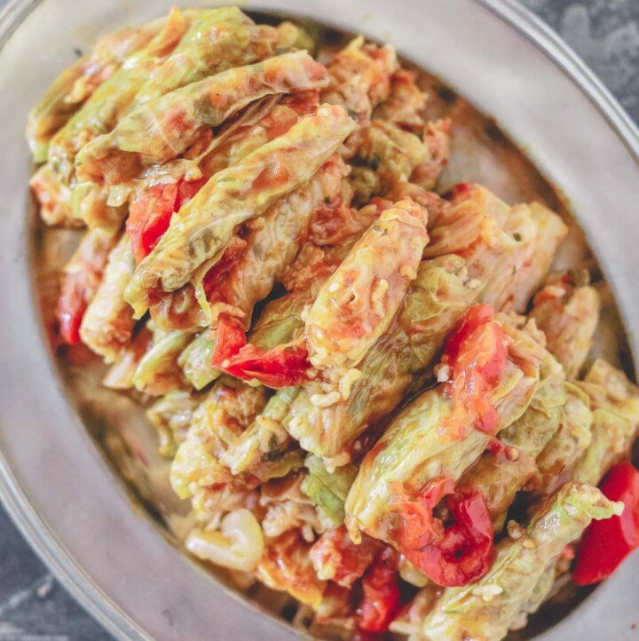 Stuffed cabbage rolls with tomatoes on a plate