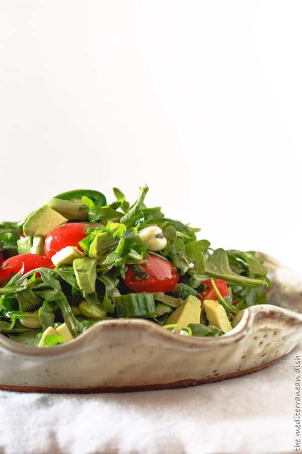 Close-up of vegetables that garnish the Arugula salad with garlic herb vinaigrette