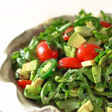 Arugula salad with avocados, fava beans and garlic herb vinaigrette from The Mediterranean Dish