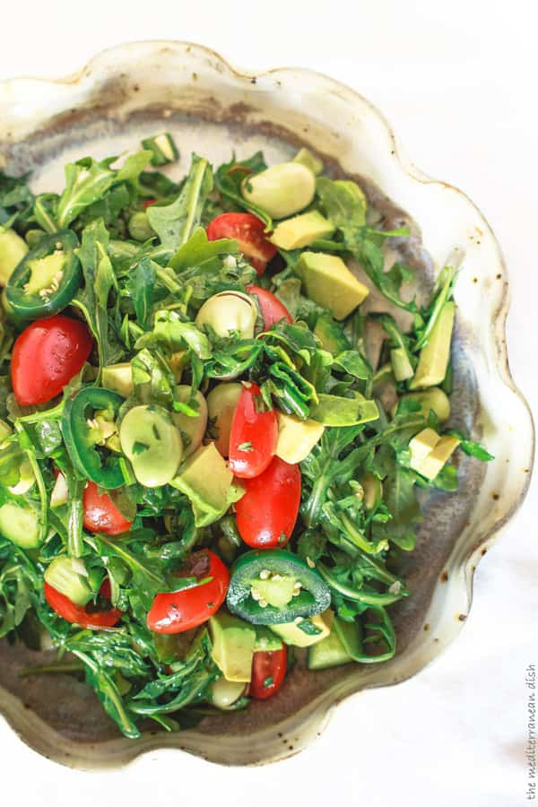 Chunky avocado and jalapeno pepper slices top off this arugula salad