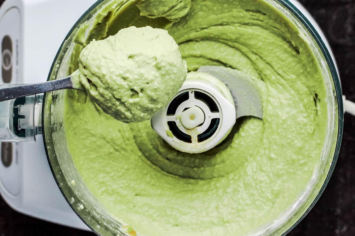 Avocado hummus mixed to a creamy texture in food processor