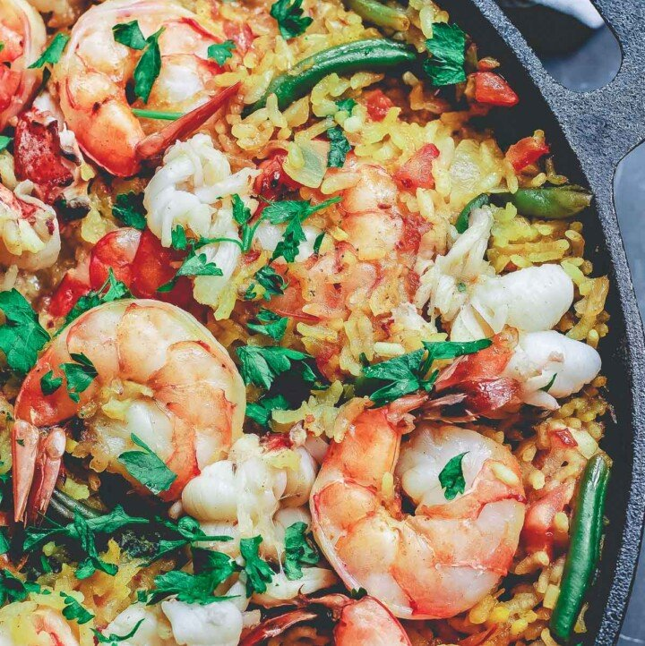 Seafood paella in a cast iron pan