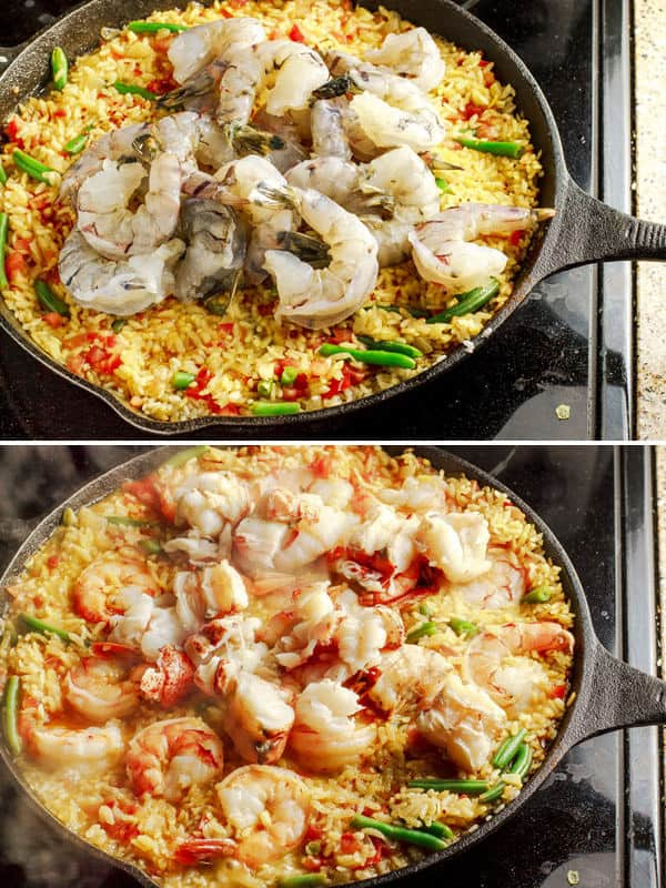 Easy Seafood Paella Recipe | The Mediterranean Dish. Recipe comes with step-by-step photo tutorial to guide your cooking! Love this shrimp and lobster nestled in a bed of saffron rice! A must try from @themeddish