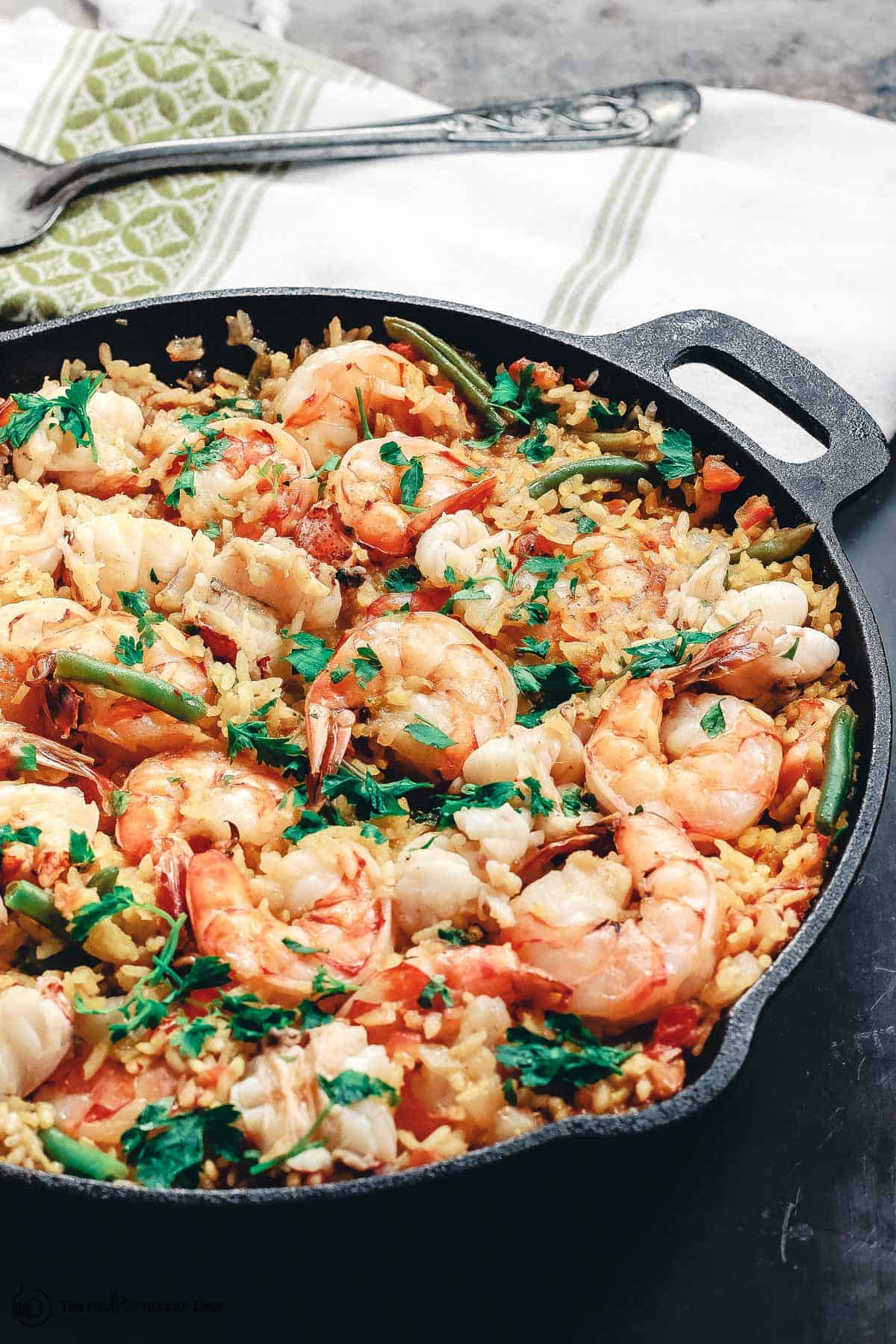 Seafood paella in a cast iron skillet