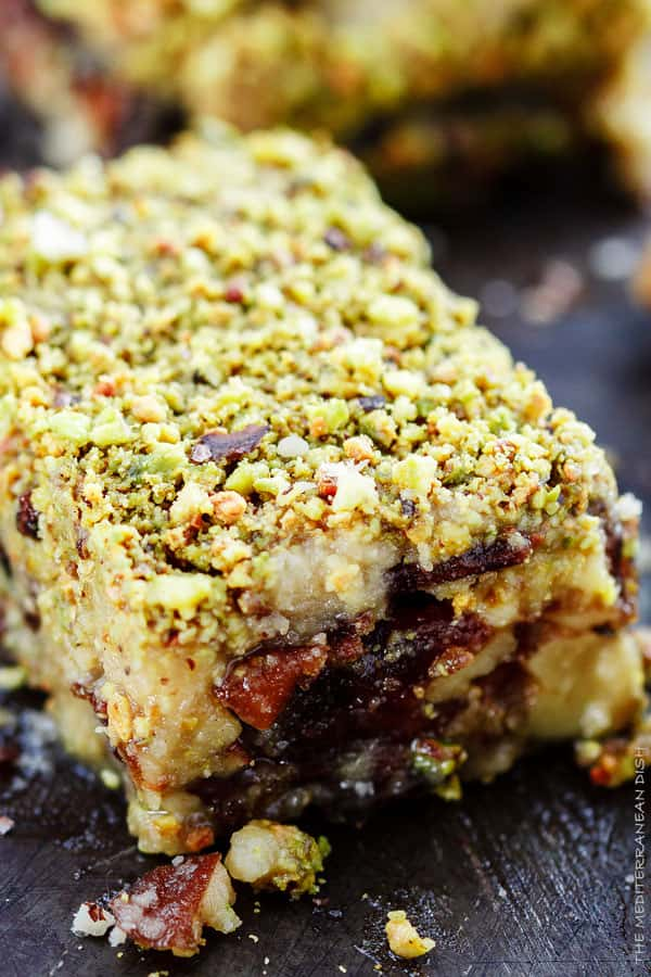 Easy No Bake Dessert Bars w/ Dates, honey and nuts! Dates stuffed with walnuts and topped with a honeyed buttery cookie and pistachios! Best part, ready in 20 minutes | The Mediterranean Dish