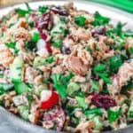 Mediterranean Tuna Salad with fresh herbs, chopped vegetables and Dijon vinaigrette on a plate
