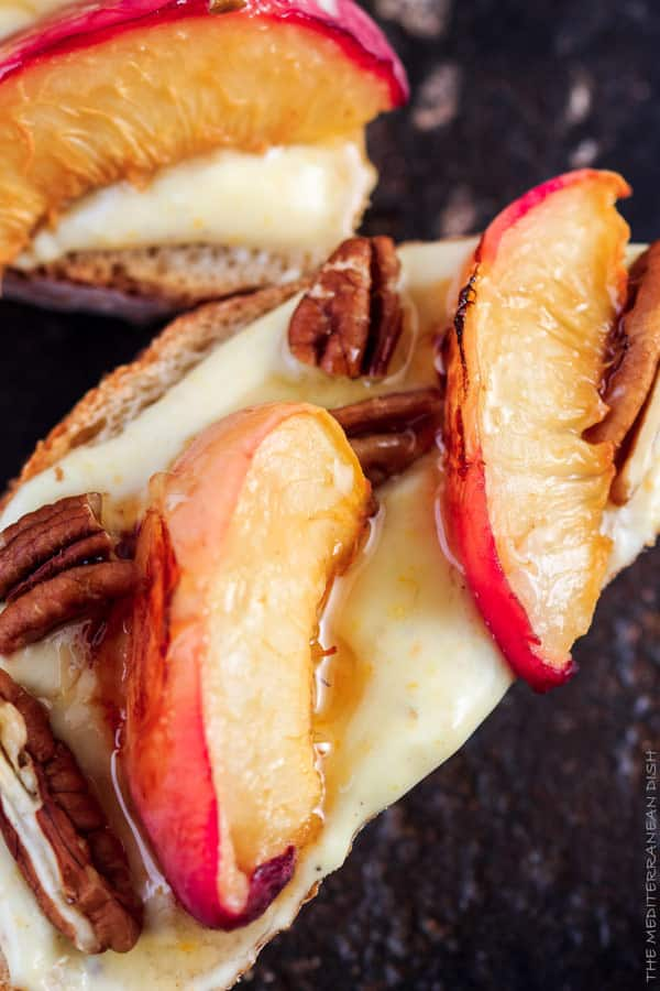 Peaches and pecans on top of crostini with yogurt